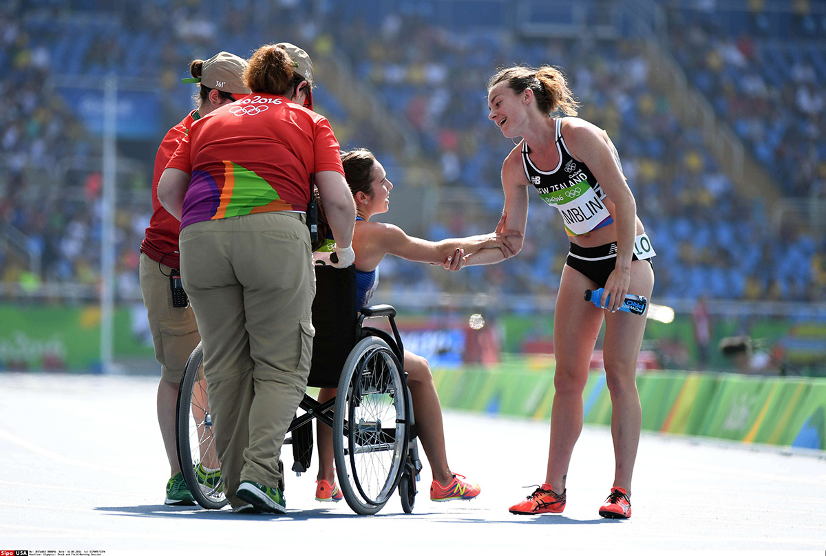 Aug 16, 2016; Rio de Janeiro, Brazil; Nikki Hamblin (NZL) helps Abbey D'Agostino (USA) into a wheelchair after the women's 5000m preliminaries in the Rio 2016 Summer Olympic Games at Estadio Olimpico Joao Havelange. Mandatory Credit: James Lang-USA TODAY Sports *** Please Use Credit from Credit Field ***/sipausa.sipausa_18212538/*** Not Available to License in China ***/1608161554
